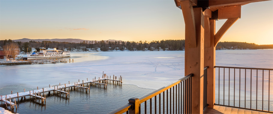 View from a hotel room deck looking Lake Winnipesaukee in winter.